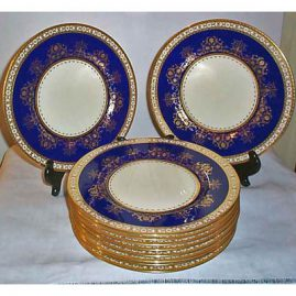12 Minton Tiffany cobalt and raised gold dinner or service plates, 11 inches, Sold