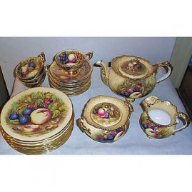 Aynsley tea set, 10 cups, 10 cake plates, teapot, sugar and creamer, signed D. Jones, sold
