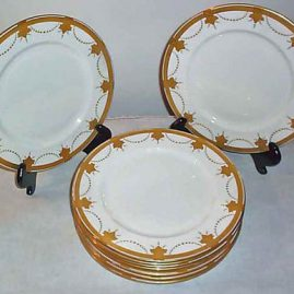 Eleven Aynsley gilded dinner plates