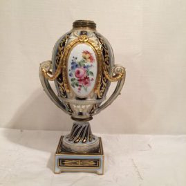 Bottom of fancy cobalt and gold porcelain oil lamp painted with portrait of Napoleon on one side and a flower bouquet on the other