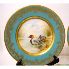 Close up of one of the six Minton bird plates signed Holland, each painted differently, Sold