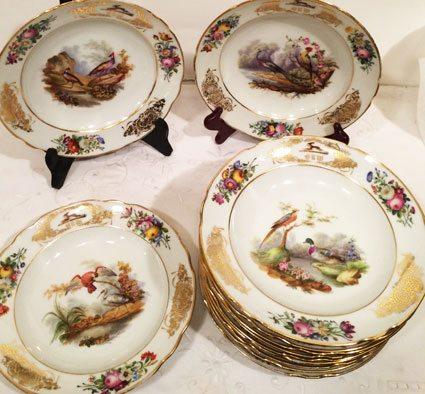 Set of twelve Paris Porcelain bird plates, each painted differently
