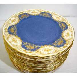 Sixteen Royal Doulton stippled blue with raised gilding dinner plates, all fluted, 10 1/2 inch diameter,. Price on Request. 12 plates are from 1923, and 4 plates are from 1935. Sold