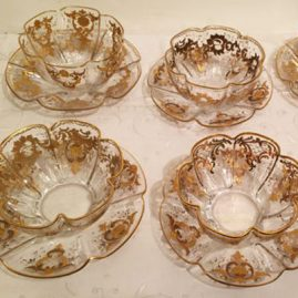 Set of twelve Moser crystal fluted bowls and underplates with raised gilding. Diameter of bowls-4 1/2 inches, diameter of under plates-6 1/4 inches. Sold