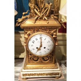 Fabulous French Bronze and marble clock with Marti works signed Boudebine, France. Height-22 inches tall, 11 inches wide and 13 1/2 inches wide on top. Working order. Circa 1880s-1890s. Sold.