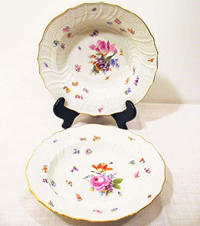 We have a service for twelve of this flower and bug Meissen dinner set including dinners, wide rim soups and dessert plates. We also have platters and other serving pieces. circa-1880s, prices on Request
