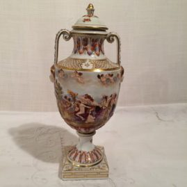 "Capodimonte urn with raised detailed decoration, 10"", late 19th century, masked faces, $1200.00"