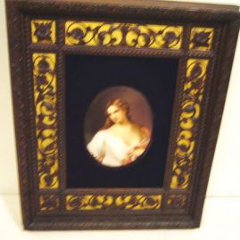Porcelain plaque of lady in fabulous wood carved frame