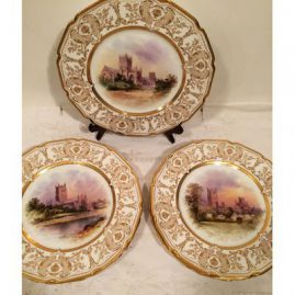 Set of seven rare Royal Doulton dinner size plates, each painted with different cathedrals, artist signed J. H. Plant, decorated with profuse raised gilding. Diameter-10 1/2 inches. Sold
