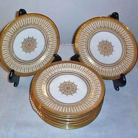 Set of twelve Cauldon luncheonj or dessert plates with raised gilding