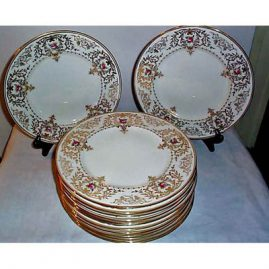 14 Cauldon dinner plates with rose and gold decoration