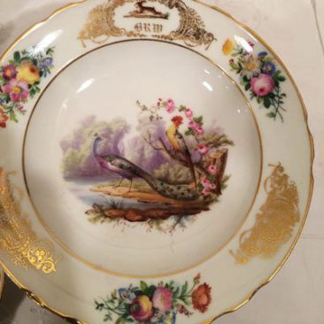 Close up of one of the Paris Porcelain bird bowls, one of the set of twelve, each painted differently