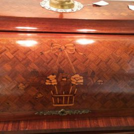 Close up of marquetry inlaid antique French cylinder desk