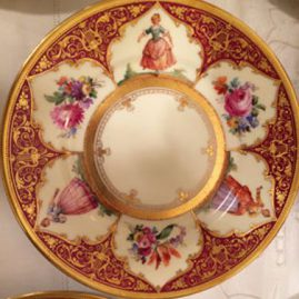 Close up of one of the set of twelve Ambrosius Lamm Dresden plates, each painted differently with different ladies and flowers with raised gilding decoration. Diameter- 7 5/8 inches. Price on Request.
