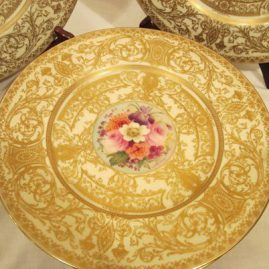 Close-up of one of the set of eighteen beautifully gilted Royal Worcester dinner plates each artist signed and painted differently with different bouquets of flowers,  10 1/2 inches in diameter, circa-1917. Price on Request