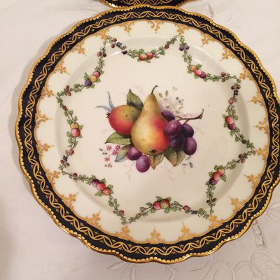 Close up of one of the twelve Royal Worcester fruit plates, each painted differently