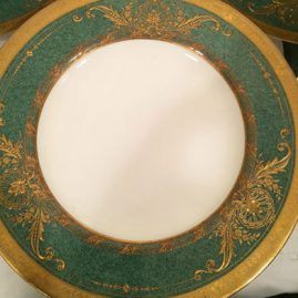Close-up of one of the set of twelve previous Royal Worcester dinner plates. This shows the heavy raised gilding on the plate and the unusual stippled green color of the plate. Price on Request.