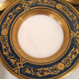 Close up of Royal Worcester blue plates with raised gilding wide rim soup bowls