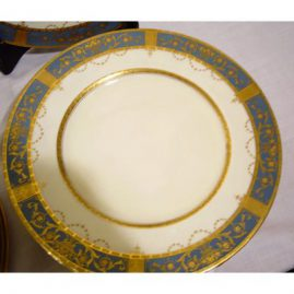 Close-up of one of the twelve Minton gilded dinner plates