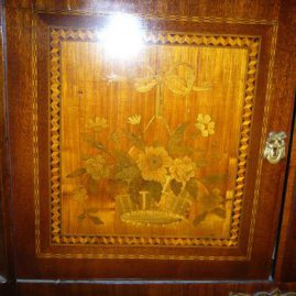 Close up of marquetry inlay of inlaid marble top cabinet