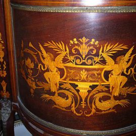 Close up of marquetry on marquetry inlaid curio cabinet