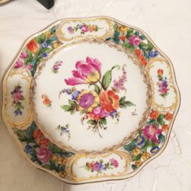 Close up of one of the set of ten Carl Thieme Potsnappel Dresden reticulated dessert plates