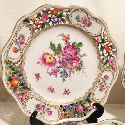 Close up of one of the four extra large Carl Thieme Potsnappel Dresden reticulated dinner plates