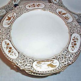 Close up of one of the set of twelve Sevres rare reticulated plates