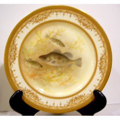 Close up of Royal Doulton Tiffany fish plates, museum quality, with raised gilding