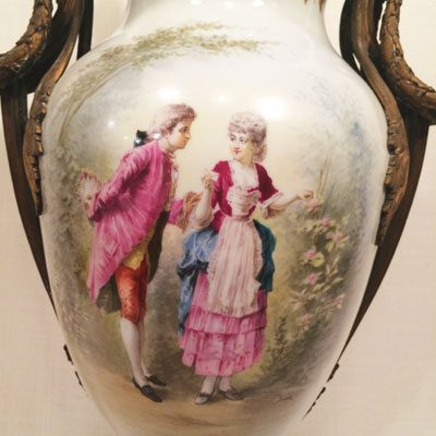 Close up of Sevres urn with scene of lovers
