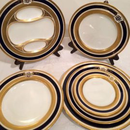 Fabulous heavily gilded cobalt blue extensive Coalport dinner service. Circa-1890-1920 in great condition. This dinner set includes: 12 bread plates, 12 lunches, 8 3/4 inches, 18 dessert plates, 8 5/8 inches, 11 wide rim soup bowls, 9 3/8 inches, 12 dinners-10 1/2 inches and 7 rare asparagus plates, 9 1/2 inches. Sold