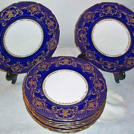 "12 Royal Doulton cobalt and gold raised gilded plates, 10 1/2"", ca-1909, some gilt wear in centers, but cobalt and gilt edge perfect, Price on Request"