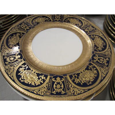 Fabulous set of ten Royal Doulton made for Tiffany dinner plates that are profusely gilded with raised gilding. size 10 1/4 inches. Sold.
