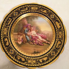Royal Vienna cobalt plate with raised gilding and blue jeweling. entitled Venus, under glaze beehive mark, ladies with a cherub, 9 1/2 inches, artist signed Riemer. Price on Request.