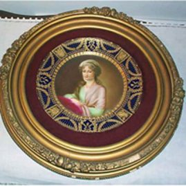 Royal Vienna framed cobalt plate of Mrs. Stone with raised gilding.