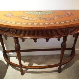Pair of console tables with flower decoration