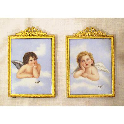 Pair of cherub porcelain painted plaques artist signed