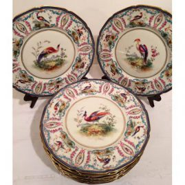 Set of twelve rare Royal Doulton exotic bird plates, hand enameled and signed E. Wood. 10 1/2 inches diameter, painted with many different birds, Circa-1914-1915, Sold
