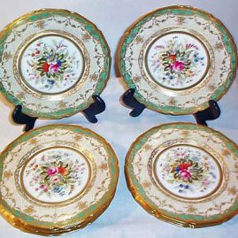 12 Royal Doulton plates signed E. Wood, each painted differently, museum quality, with raised gilding, 1927, 9 inches, price on request