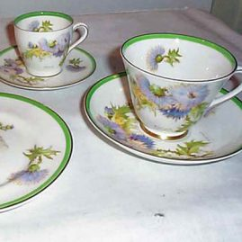 Royal Doulton Glamis Thistle set by Percy Curnock, 8 plates-$495, 9 cups-$630, 6 demitasse-$420