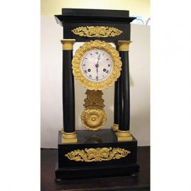"French Empire clock, working condition, 18 1/2"" tall, rings on hour and half hour, Sold"