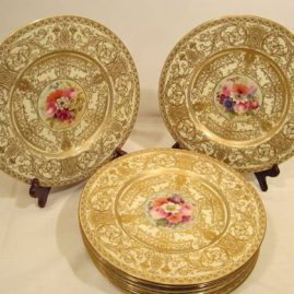 Set of eighteen beautifully gilted Royal Worcester dinner plates each artist signed and painted differently with different bouquets of flowers,  10 1/2 inches in diameter, circa-1917. Price on Request