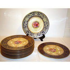 12 Royal Worcester dinner fruit plates each artist signed and each painted with different fruits in the centers with cobalt and gilt borders. Sold