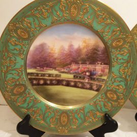 Royal Worcester garden plate with beautiful gardens and raised gilding of The Garden of Rydal Hall in Westmoreland, circa 1928,  Price on Request