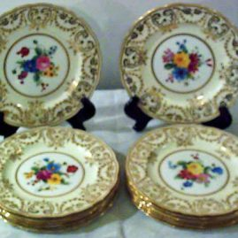 Set of twelve George Jones made for Tiffany dessert plates each painted differently