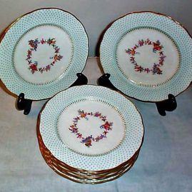 12 George Jones luncheon or dessert plates with  raised aqua enamel jeweling, 9 inches, Price on Request