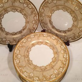 Set of eleven Royal Doulton gilded dinner or service plates. Circa-1910. Size-10 3/8 inches. The plates were exclusively made for Davis Callamore and Company,Fifth Avenue & 48th St., New York. Beautiful raised gilding. Price on Request.