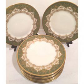 Set of twelve profusely gilded green Royal Doulton dinner plates. 10 1/2 inch diameter. circa-1918. Made exclusively for Davis Collamore and Co Inc, Fifth Avenue and 48th St., New York. Sold