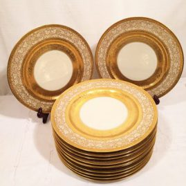 Set of twelve gilded Heinrich and Company service or dinner plates. Circa-1930s. Price on Request