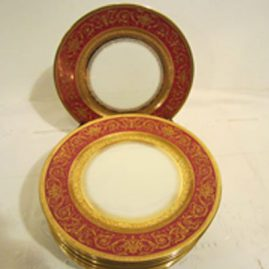 Set of twelve ruby Limoges luches or salad plates with raised gilding